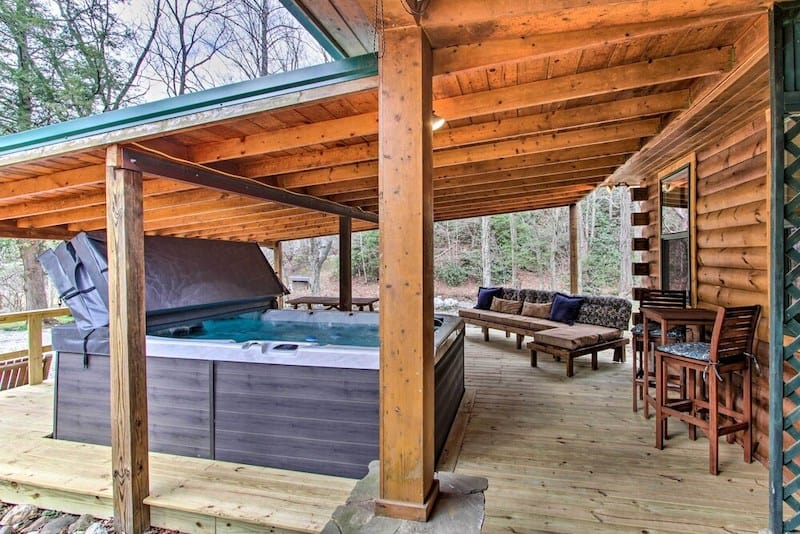 The deck at hot tub at Creekside Cabin in Gatlinburg - a great pet friendly option for groups.