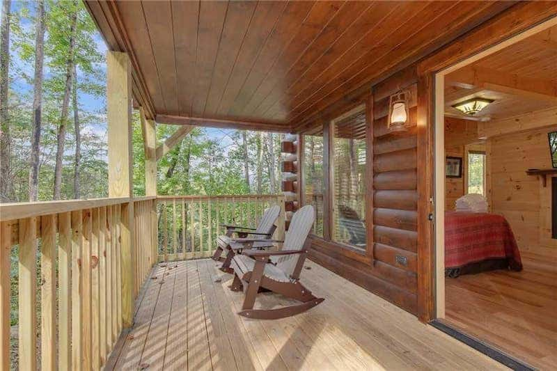 Outdoor deck with chairs at Simply Unforgettable Cabin in Gatlinburg TN